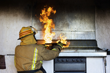 a fireman fights a kitchen fire